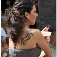 Little black and white cross with praying hands tattoo on shoulder