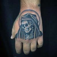Little black and white death skeleton tattoo on hand