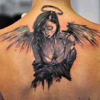 Little black ink abstract sad angel tattoo on upper back