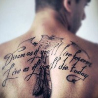 Little black ink lettering with feather tattoo on upper back
