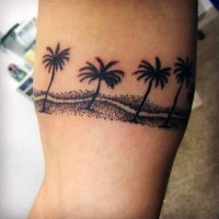 Little black ink palm trees tattoo on leg