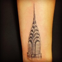 Little black ink real life like Empire State Building tattoo on wrist
