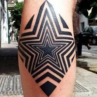 piccolo inchiostro nero forma di stella ipnotica tatuaggio su gamba