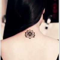 Little black lotus flower tattoo on back