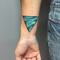 Little blue colored mysterious triangle tattoo on wrist