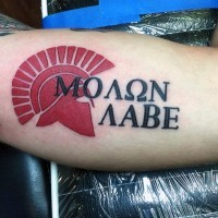 Little colored Latin lettering with warrior emblem tattoo on arm