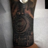 Little colored old steamy train tattoo on wrist