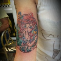 Little cute looking colored mermaid portrait tattoo on arm with lettering