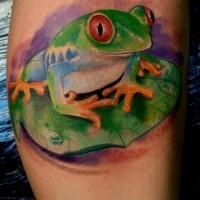 Little frog sitting on a green leaf tattoo
