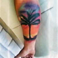 Little magnificent colored big palm tree tattoo on arm