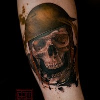 Little natural colored forearm tattoo of military soldier skull