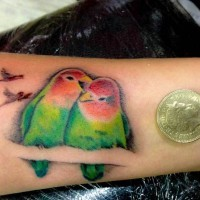 Love birds tattoo design on wrist