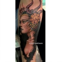 Lovely colored very detailed forearm tattoo of evil witch with nice earrings