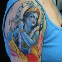 Lovely deity krishna with flute tattoo on shoulder