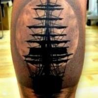 Lovely ship at sunset tattoo on leg