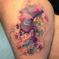 Lovely watercolor jellyfish tattoo on thigh