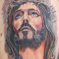 Lovely watercolor jesus tattoo on shoulder