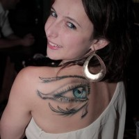 Magnificent 3D realistic stylized Egyptian ancient symbol the Eye of Horus colored tattoo on lady's shoulder blade