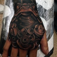 Magnificent colored mystical frog statue tattoo on hand