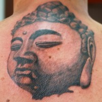Magnificent huge Buddha's portrait with closed eyes upper back Buddhist tattoo