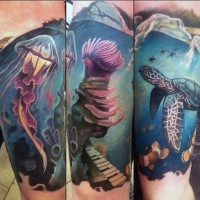 Magnificent painted very beautiful jellyfish with turtle tattoo on arm