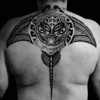 Marvelous big black ink ray tattoo on back stylized with tribal ornaments and lettering