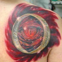 Marvelous detailed 3D Dragon eye with the ring of Sauron tattoo on shoulder