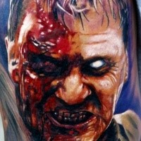 Marvelous very detailed colored horror style shoulder tattoo of zombie man face