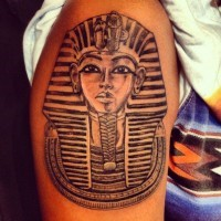 Mask of pharaoh tattoo on arm