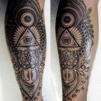Massive black and white half nautical half masonic style detailed tattoo on leg