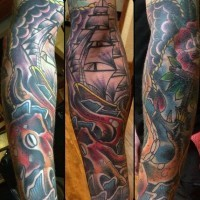 Massive multicolored nautical themed tattoo with octopus and ship tattoo on sleeve