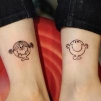 Matching cute friendship tattoos on legs