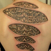 Mechanisms under skin tattoo on back
