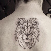 Medium size black and white lion's head tattoo on upper back in linework style