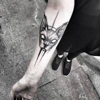 Medium size black ink cat head tattoo sketch painted by Inez Janiak on forearm