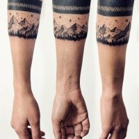 Medium size black ink forearm tattoo of night mountains