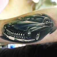 Medium size colored arm tattoo of classic car