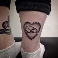 Medium size cute looking leg tattoo of heart shaped tattoo with sleeping cat