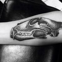 Medium size dot style animal skull tattoo on forearm