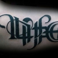 Medium size typical black ink ambigram tattoo on arm
