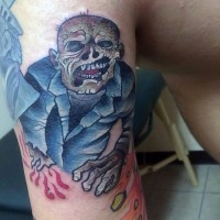 Medium sized colored homemade colored monster zombie tattoo on biceps