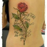 Memorial style big colored rose with lettering tattoo on back