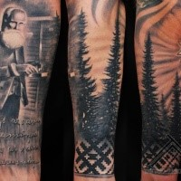 memorial style black and white forearm tattoo of old man with lettering and forest