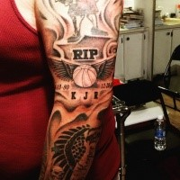 Memorial style black and white sleeve tattoo of basketball with wings and lettering