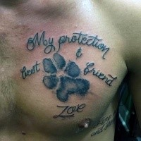 Memorial style black ink chest tattoo of animal paw print with lettering