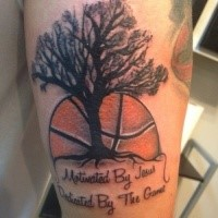 Memorial style colored thigh tattoo of lonely tree with basketball and lettering