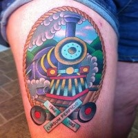 Memorial style colored thigh tattoo of steam train with lettering