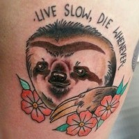 Memorial style painted nice sloth with flowers and lettering tattoo on thigh