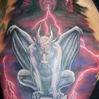 Menasing colorful gargoyle tattoo