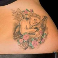 Merry cherub playing a mandolin tattoo on lower back